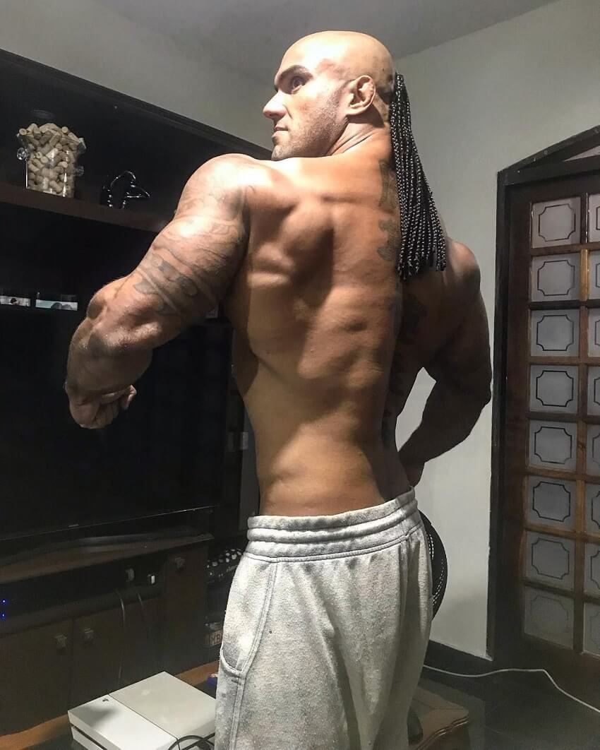 Danilo Franca spreading his lats wide in a room
