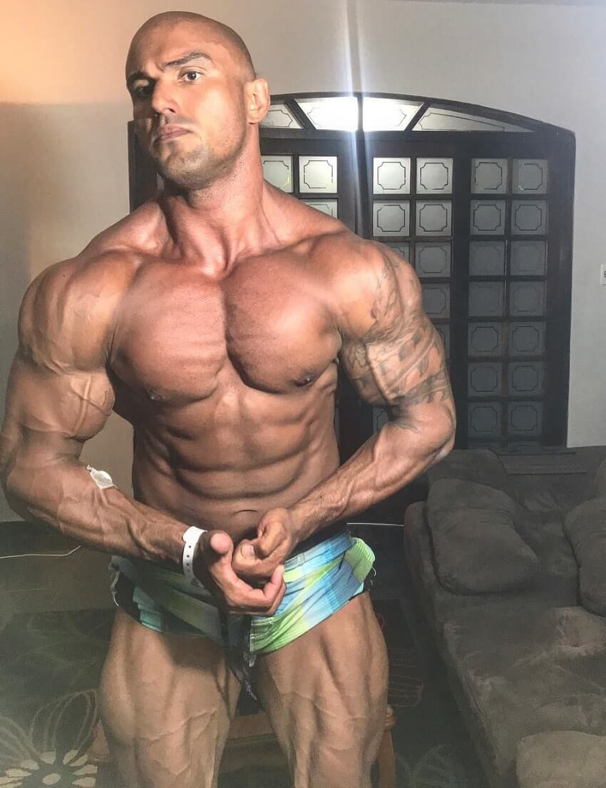 Danilo Franca flexing shirtless looking ripped and swole