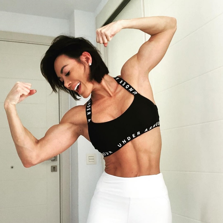 Danni Levy flexing her biceps for the camera