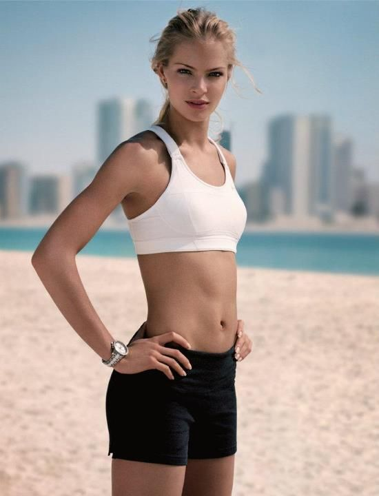 Darya Klishina posing in a professional fitness photo shoot, looking lean and healthy