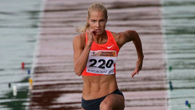 Darya Klishina running to make a long jump during a competition