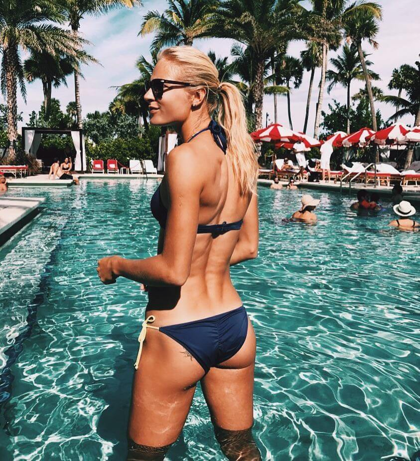 Darya Klishina standing in the pool looking fit