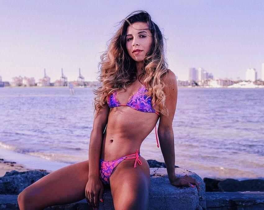 Diana Rinatovna posing by the sea in her bikini, looking fit