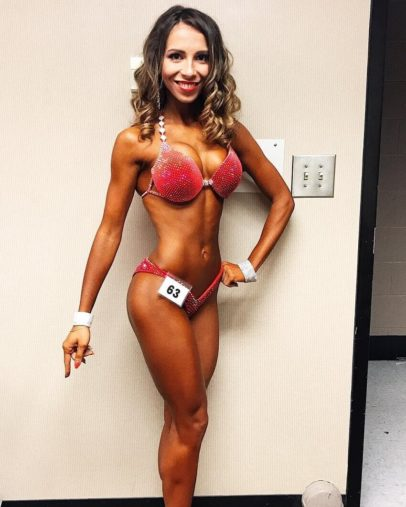 Diana Rinatovna posing in her competitive bikini outfit looking fit and lean