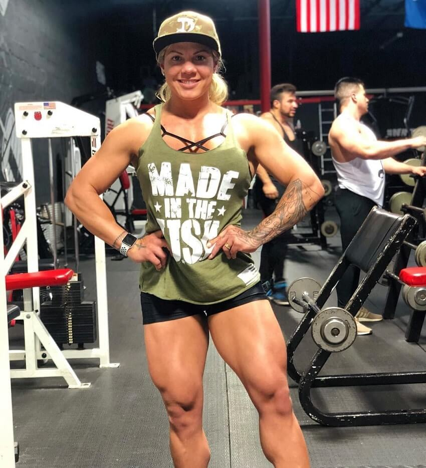 Dora Rodrigues posing in the gym looking strong and fit