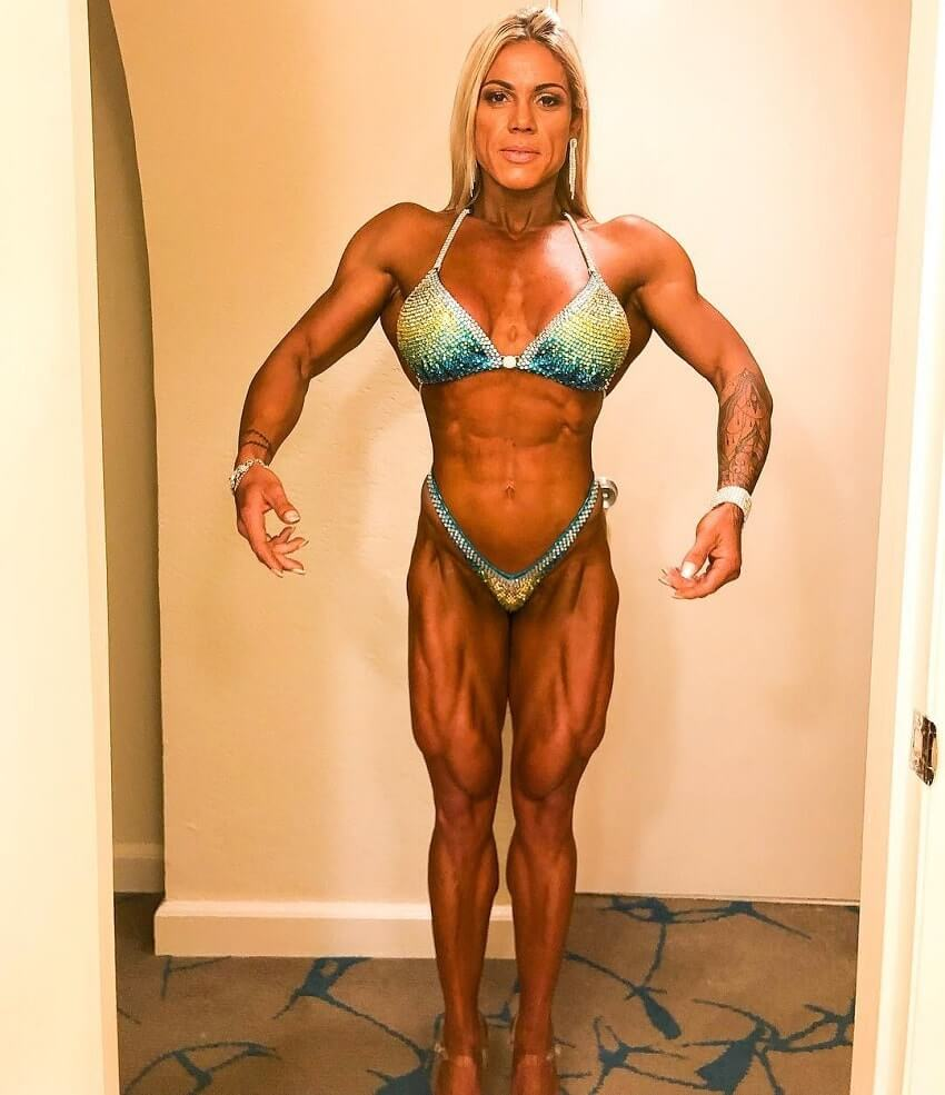 Dora Rodrigues practicing posing for a contest, wearing a bikini, looking fit and strong