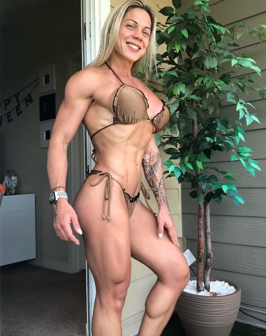 Dora Rodrigues posing in a bikini looking fit and strong