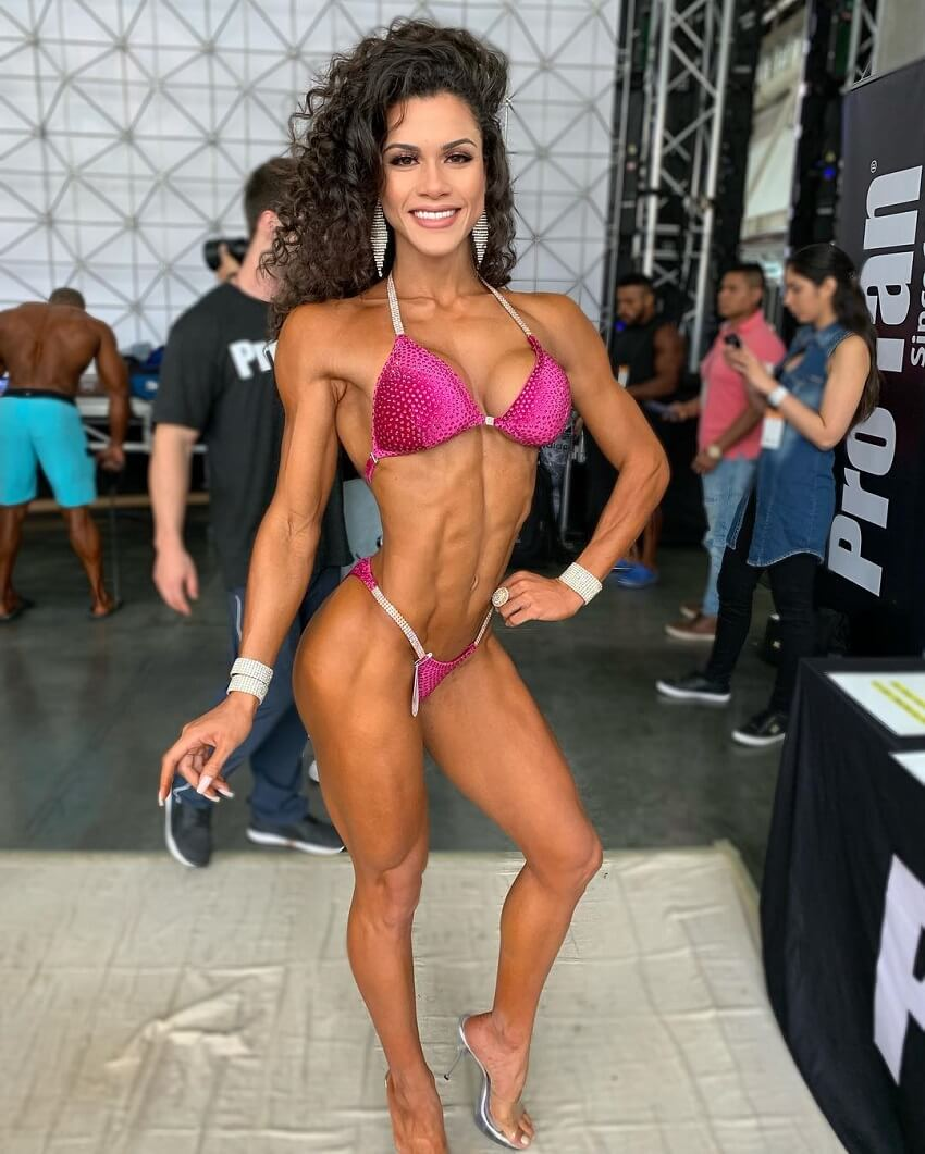 Etila Santiago posing backstage during a bikini contest