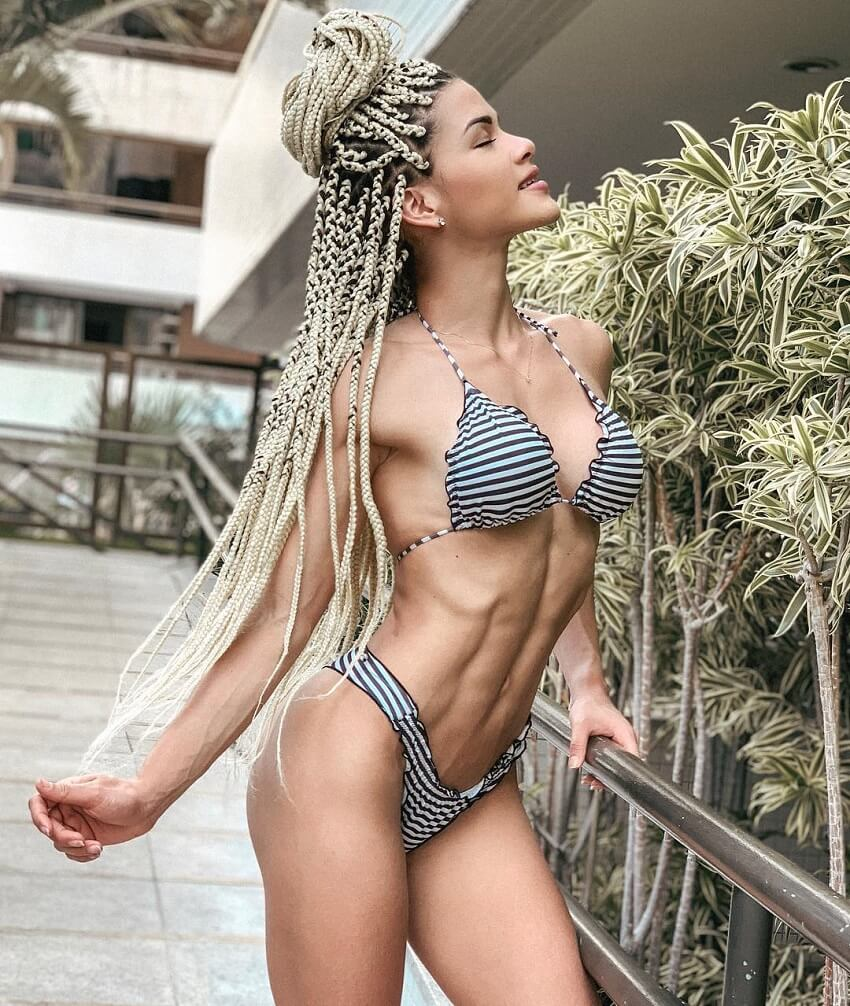 Etila Santiago posing in a bikini looking fit and lean