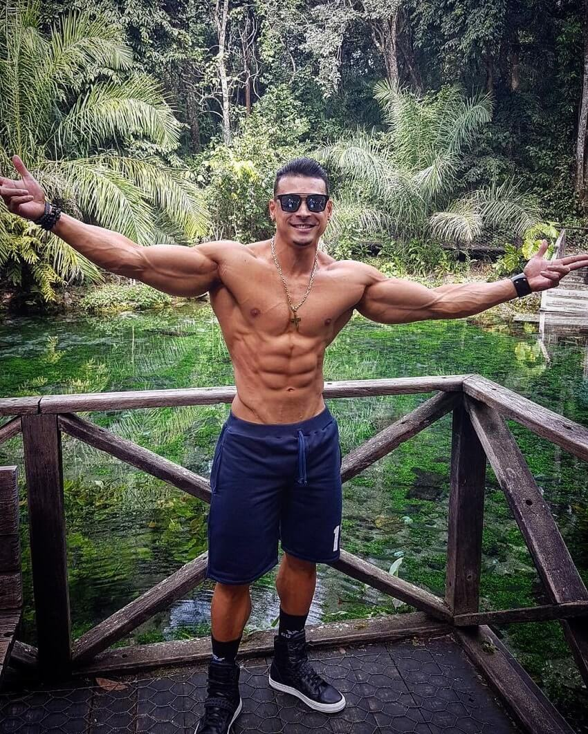 Felipe Franco posing shirtless in nature