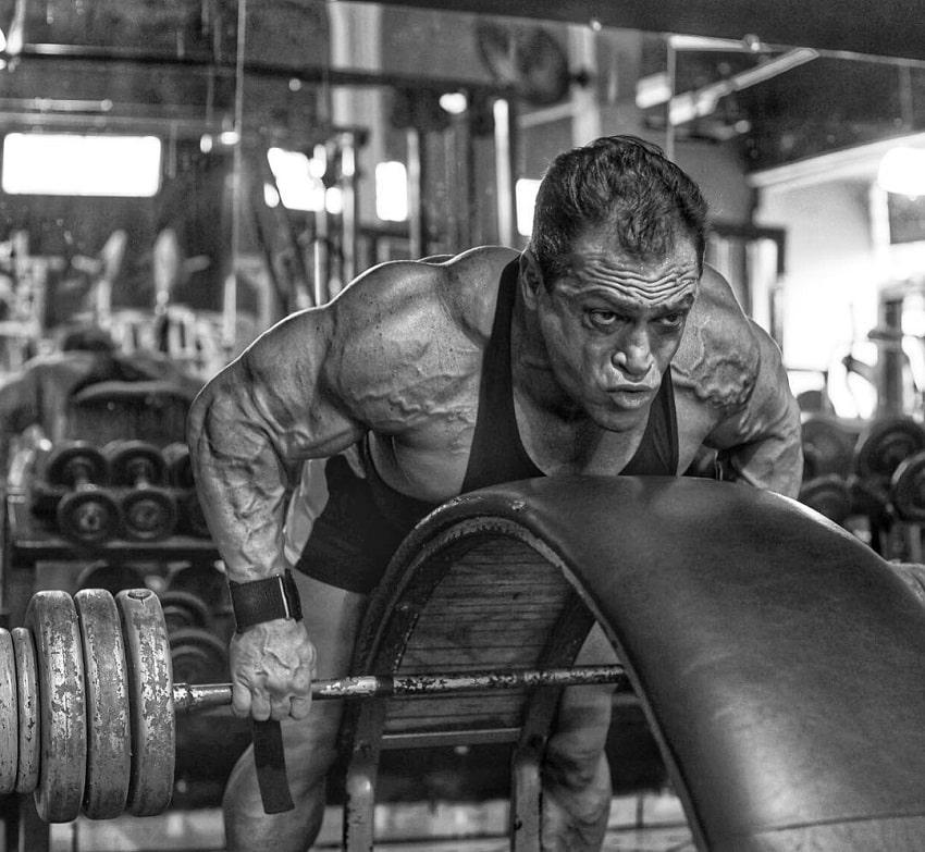 Fernando Sardinha doing heavy barbell rows in the gym