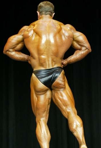 Gary Strydom performing a rear lat spread pose on the bodybuilding podium