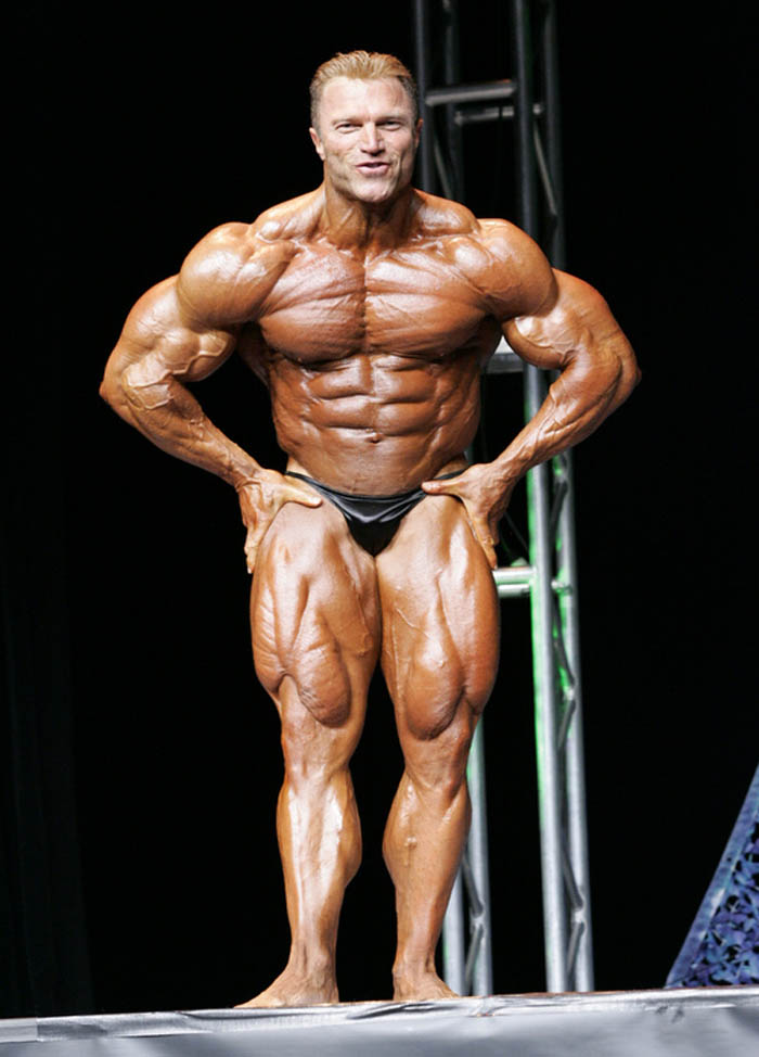 Gary Strydom flexing in a bodybuilding contest looking ripped
