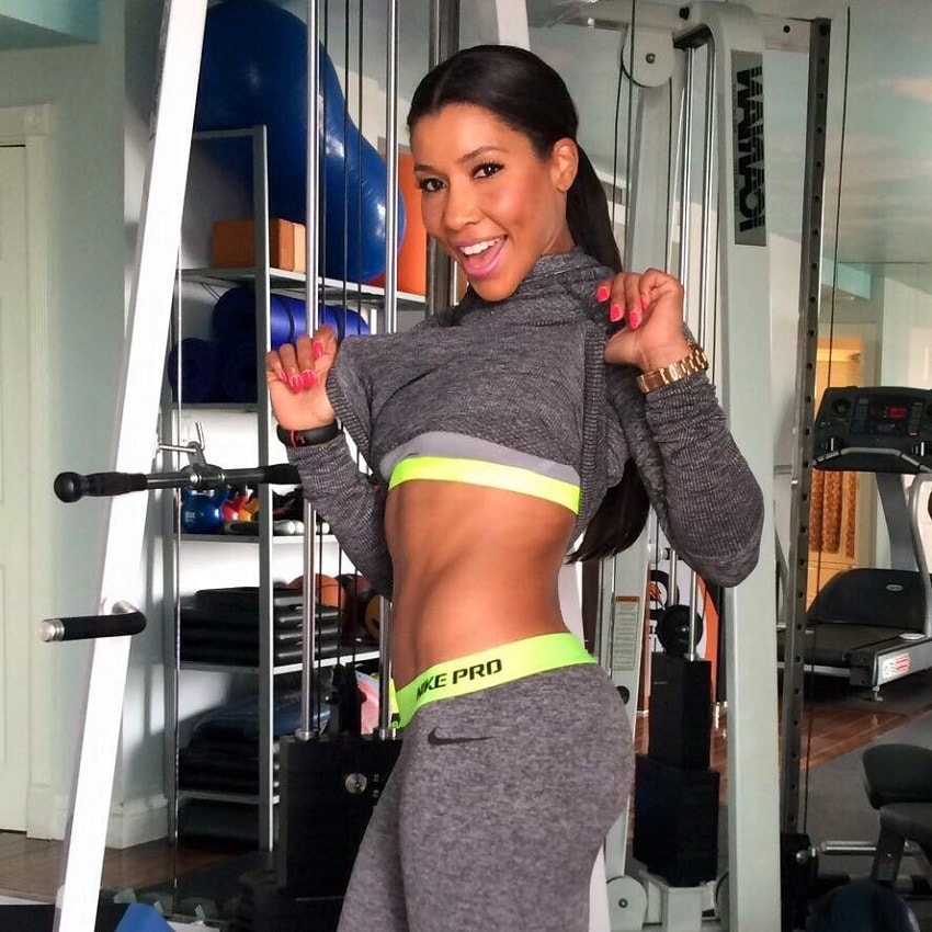Jeanette Jenkins showing off her lean abs in the gym