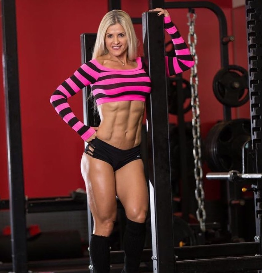 Karen Domingos posing in a fitness photo shoot looking ripped
