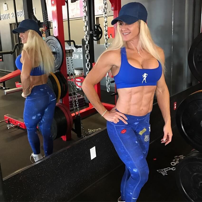 Karen Domingos posing by the gym mirror