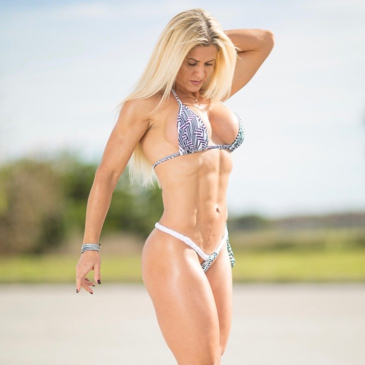 Karen Domingos posing in a bikini outdoors, looking fit and lean