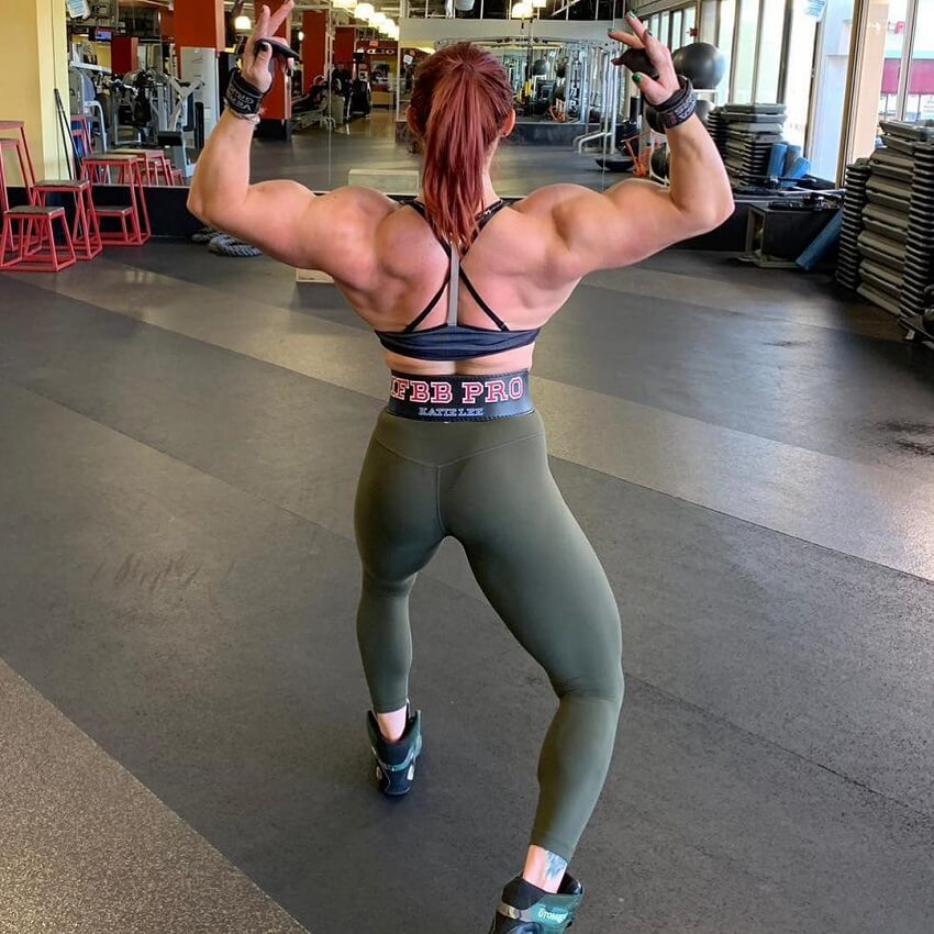 Katie Lee practicing posing for Women's Physique in the gym
