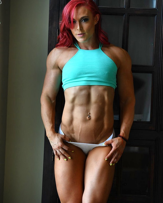 Katie Lee flexing her ripped and vascular abs