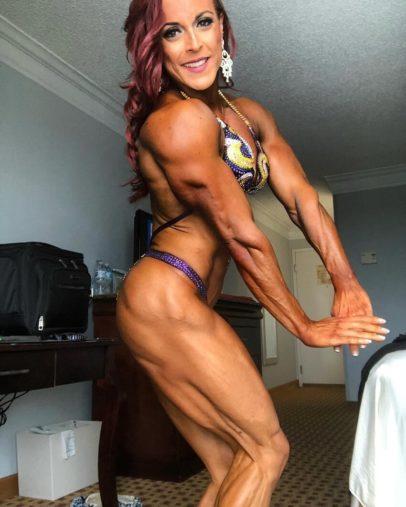 Katie Lee flexing her muscles in a bikini