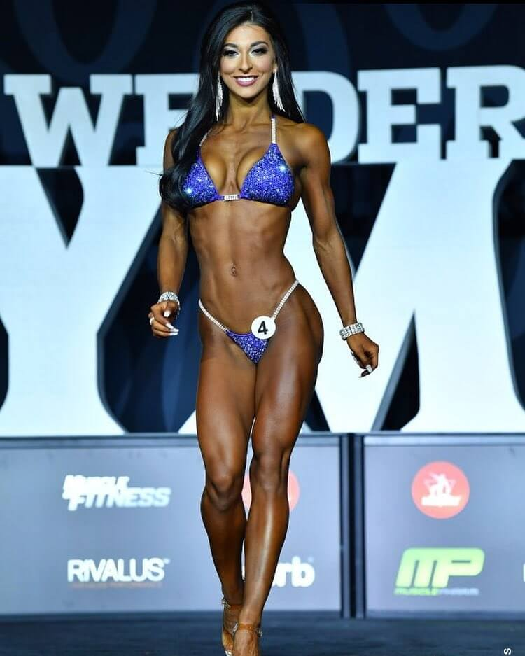 Lauralie Chapados walking down the Joe Weider's Mr. Olympia stage