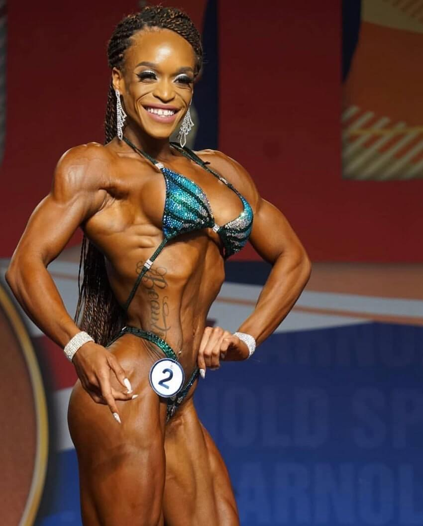 Lola Montez competing on a fitness and figure stage