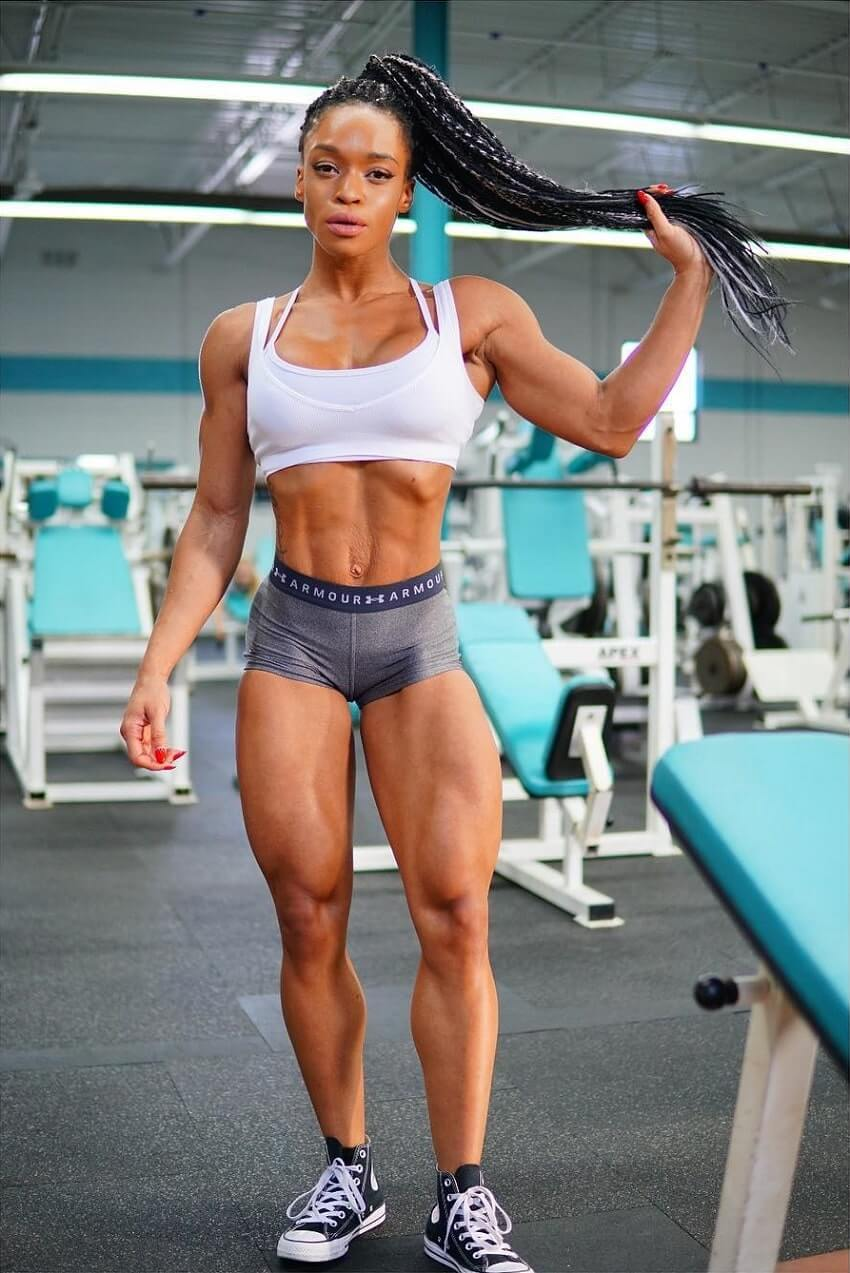 Lola Montez posing in the gym looking fit and lean