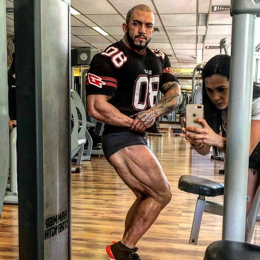 Matheus Donaire flexing his legs in the gym
