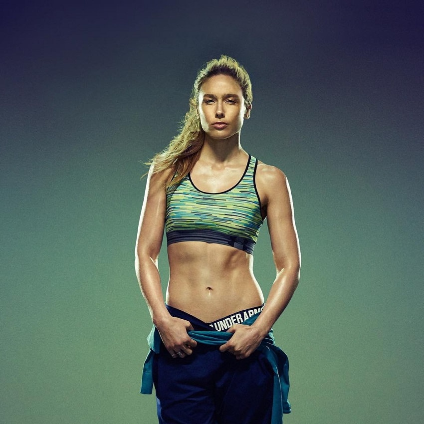 Natalie Uhling posing in a fitness photo shoot looking lean and fit