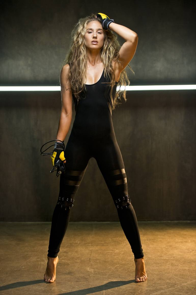 Natalie Uhling posing in a fitness photo shoot, wearing boxing gloves