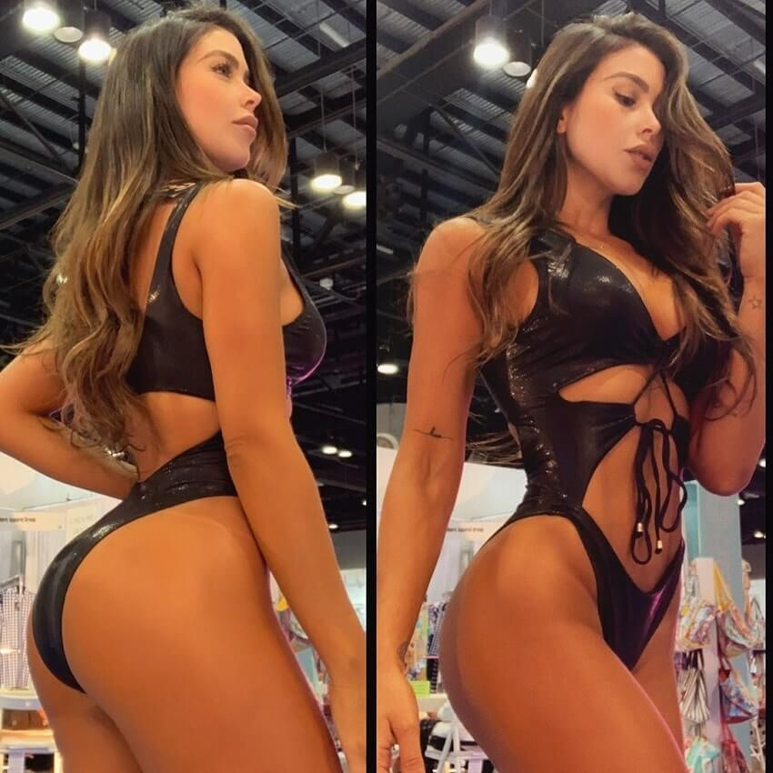Paola Canas posing during a fitness expo, looking fit and lean