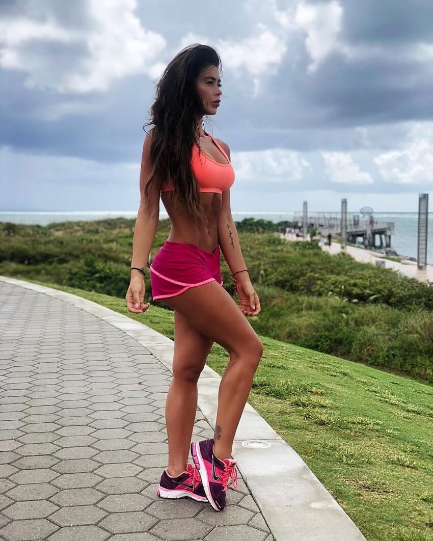 Paola Canas standing outdoors in sports clothes looking fit and lean