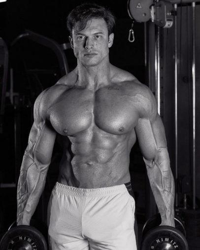 Paulo Muzy posing shirtless for a fitness photo shoot