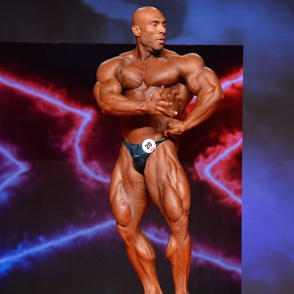 Samir Troudi doing a pose on a bodybuilding stage