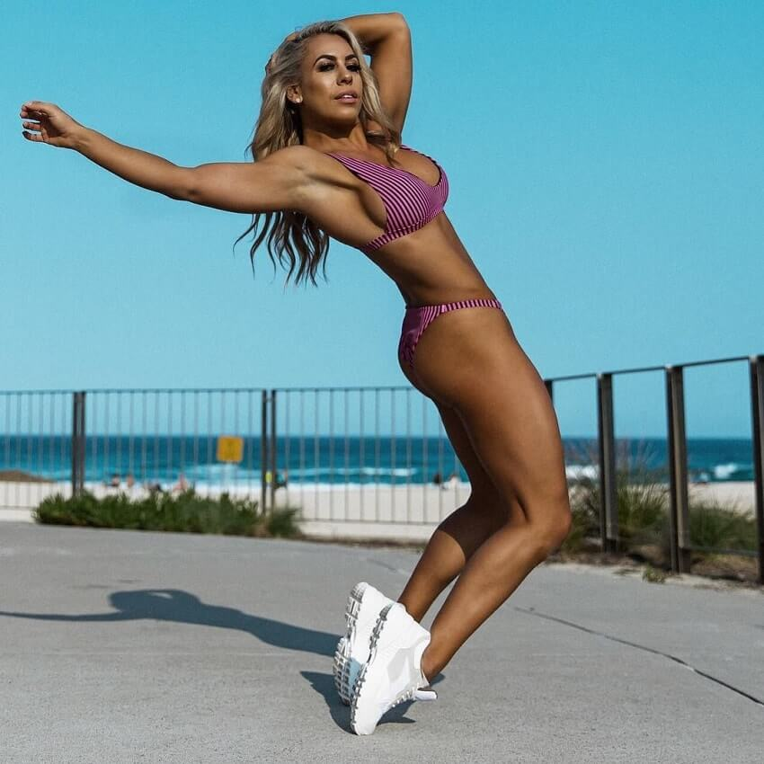 Tamara Meyer doing acrobatics outdoors, looking lean and fit