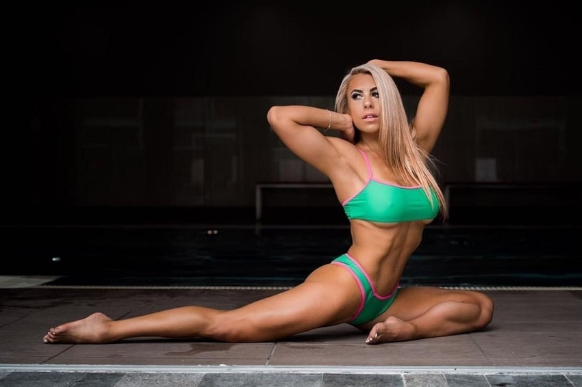 Tamara Meyer stretching and posing for the photo