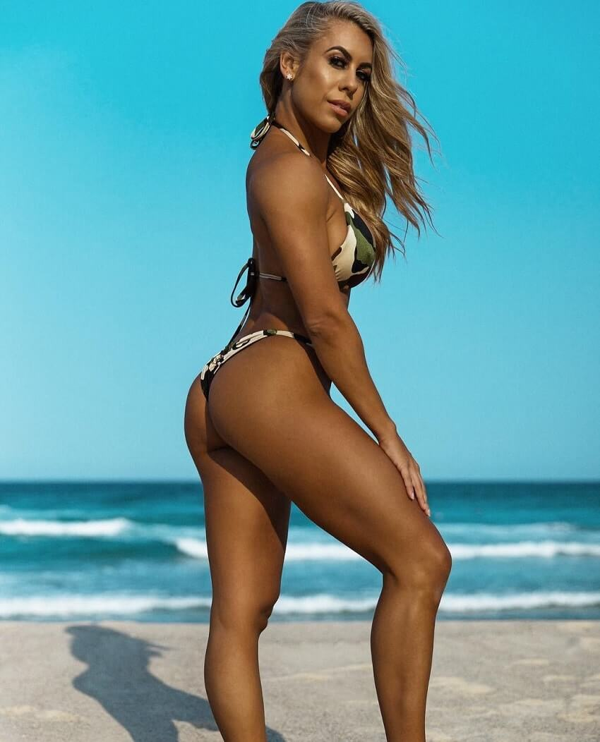 Tamara Meyer posing on the beach looking fit
