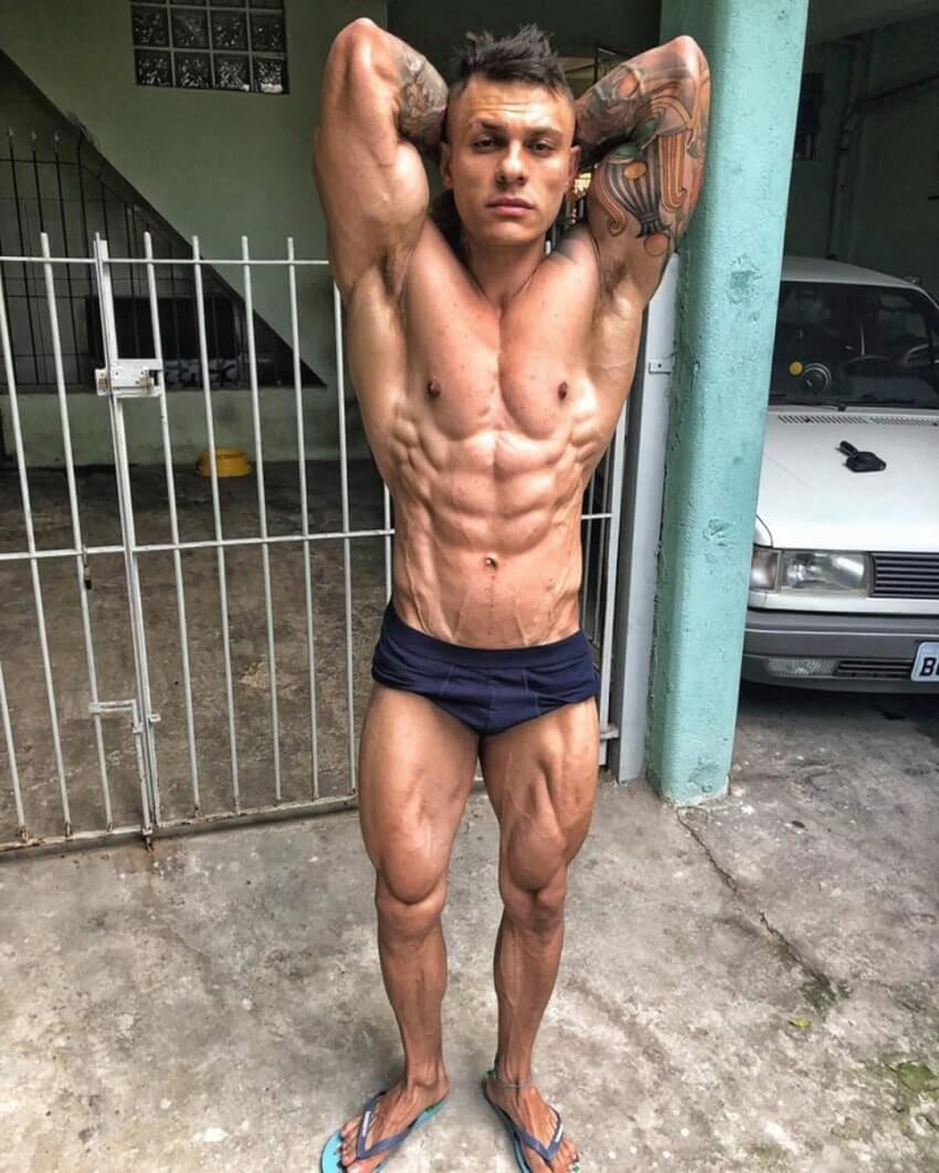 Tiago Toguro flexing his abs for the photo looking ripped