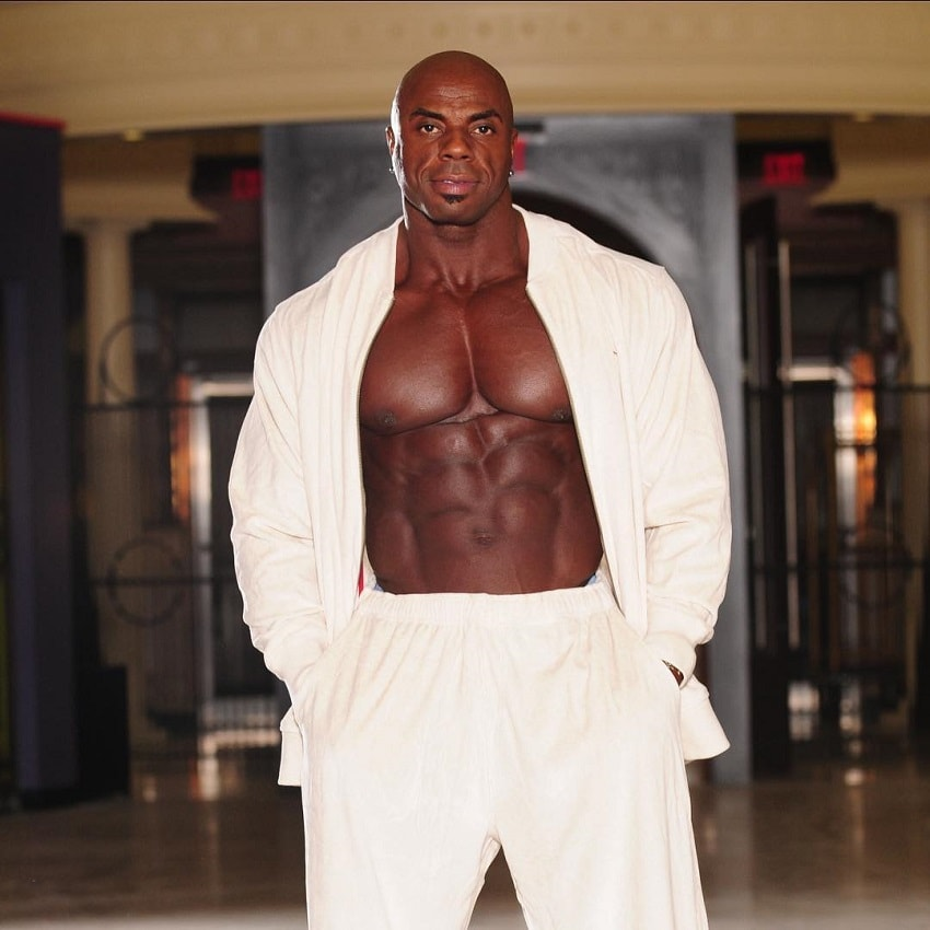Toney Freeman posing in an exotic white outfit looking huge and ripped