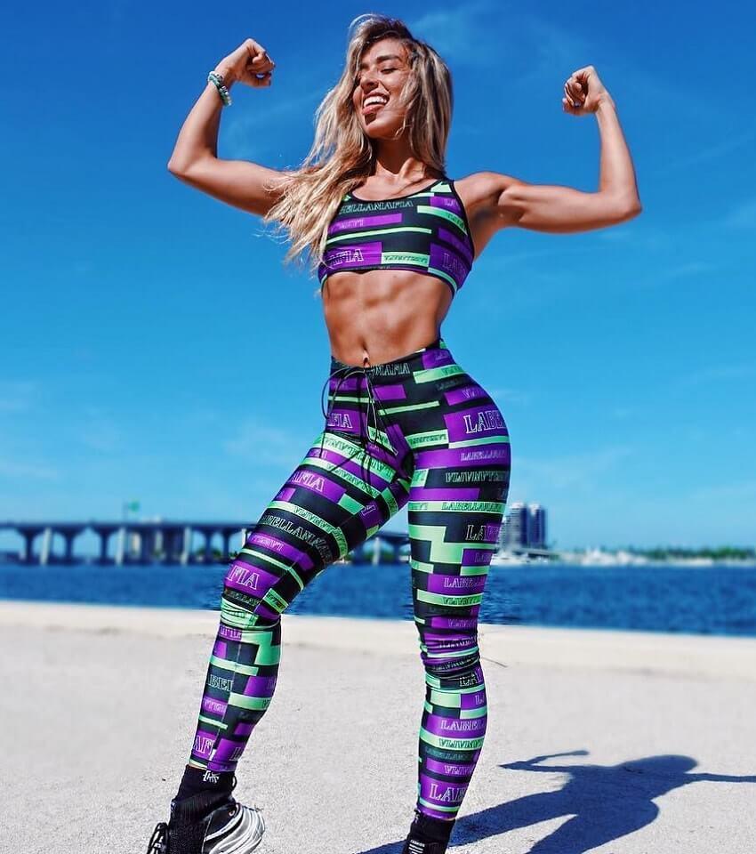 Vanesa Seco flexing her biceps outdoors