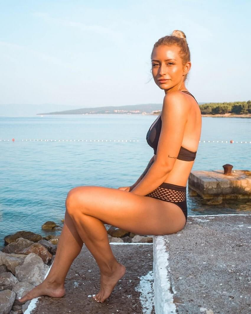 Wilda Fox sitting on a beach in Croatia, looking fit and healthy