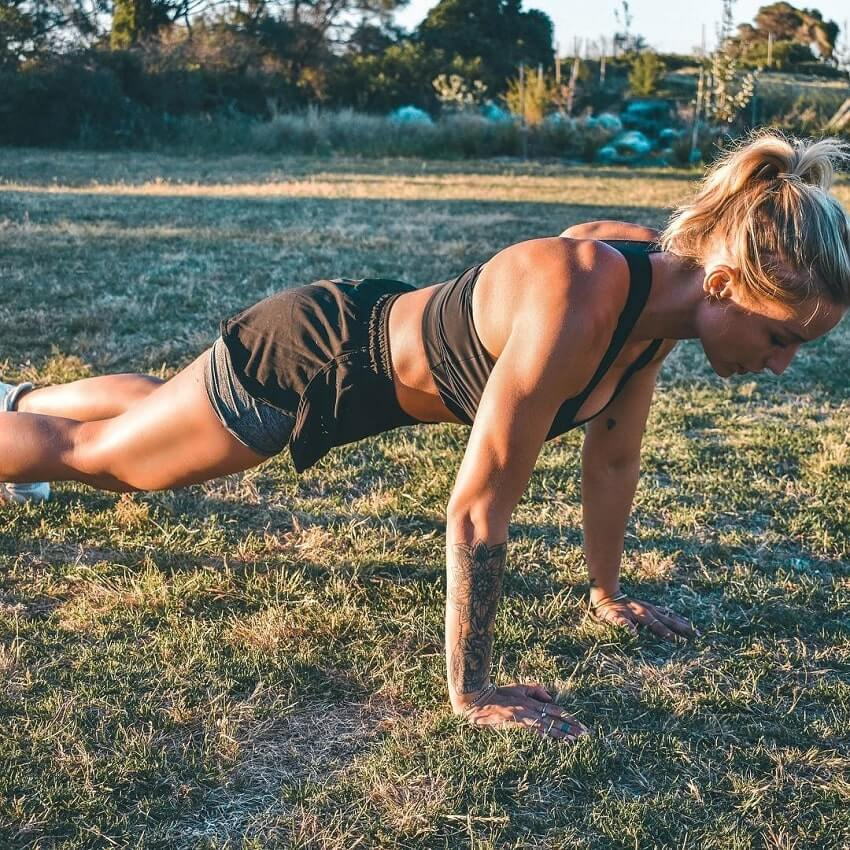 Wilda Fox doing pushups outdoors
