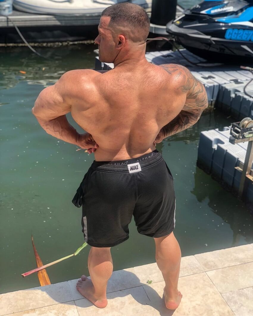 Aaron Polites doing a rear lat spread near a river