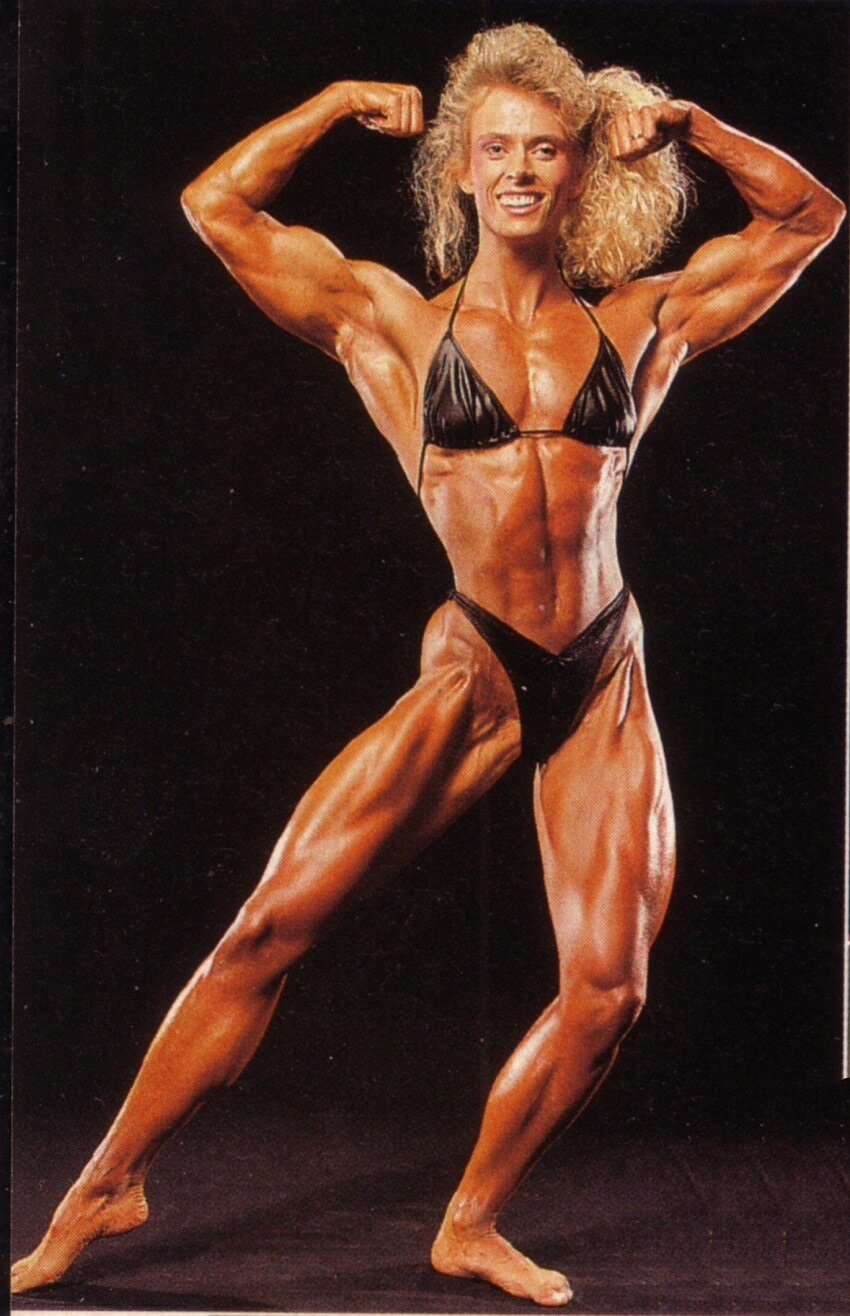 Anja Schreiner showing her front double biceps pose, looking fit and muscular
