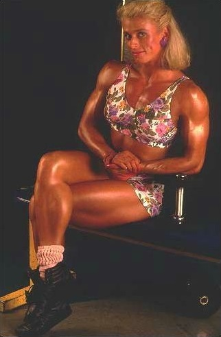 Anja Schreiner sitting on a chair looking fit and muscular