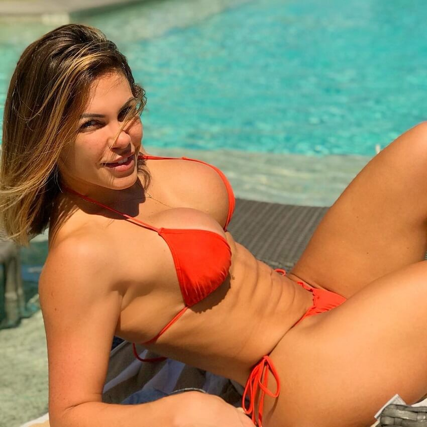 Caroline Grillo lying by a pool looking fit and lean