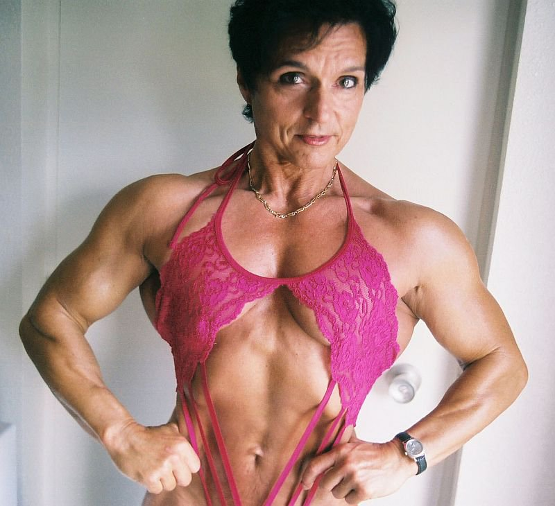 Christa Bauch posing for the photo looking fit and lean