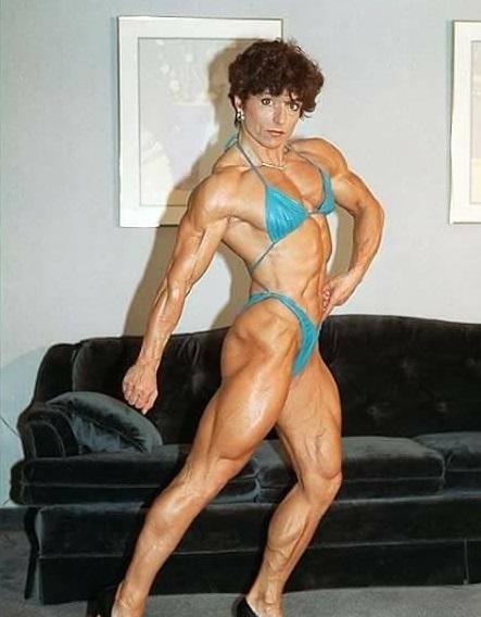Christa Bauch posing in a bikini in her house