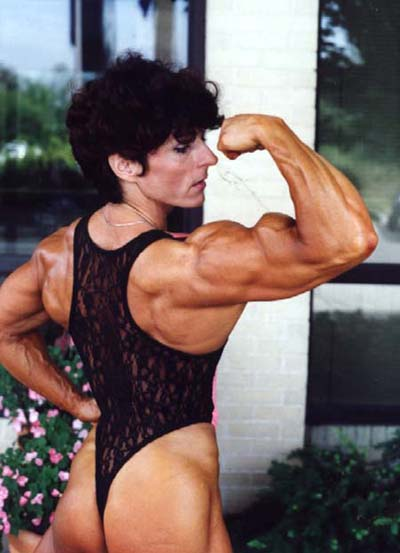 Christa Bauch flexing her awesome and muscular arm for the photo