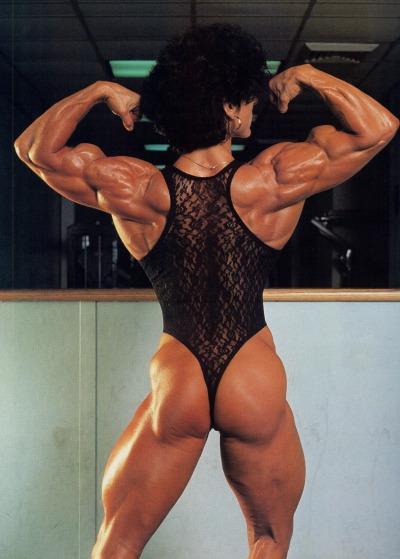 Christa Bauch doing a back double biceps pose